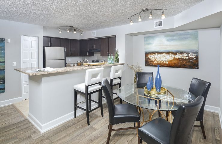 open kitchen with breakfast bar and dining area
